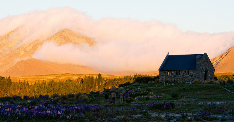 I simply gave up taking this shot without anyone in it. So say hi to fellow photo travelers Roger, Barun, and Claude. The town of Tekapo starts 30 meters to the right of the chapel.