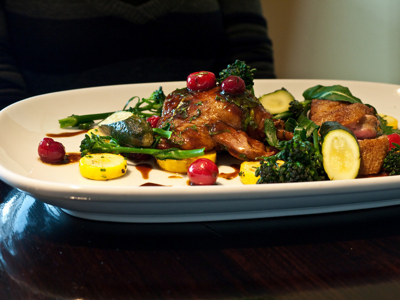 Confit duck leg, roasted breast, courgettes, cranberries and flowering broccoli