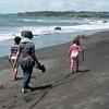 Eli, Chloe and Grandma on the beach between Ahu Ahu and Oakura.