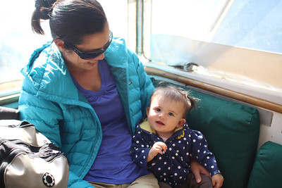 Malia snuggling with Jayna on the Milford Sound cruise.