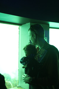 Shane and Malia watch the fish in the underwater observatory at Milford Sound.