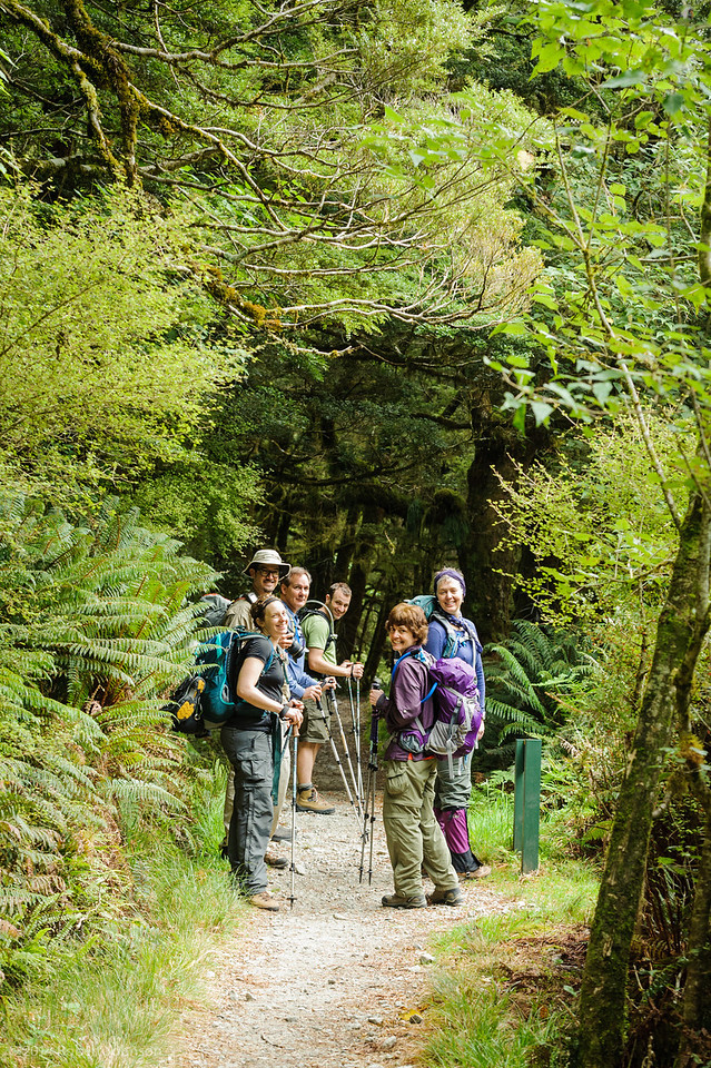 A group of happy hikers on the Milford Track near the West Branch of the Clinton River