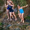 Chloe and friend jumping into the Oakura River.