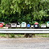 Mailbox row at Kuoatunu Bay -- almost all boxes different from one another.