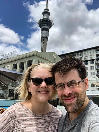 Both of us with Sky Tower in the background. At the rooftop pool.