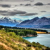 Lake Pukaki along Mt Cook Road, South Island New Zealand<br />  Feb 2014<br />  Lake Pukaki is formed by retreating glaciers. Silt and debris carried by meltwater forms the outwash plain seen at the base of the mountains forming the upstream border of the lake.