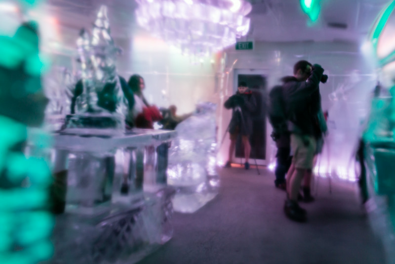 The Minus 5 Ice Bar in Queenstown, New Zealand, where everything, including the chandeliers, and even the drink glasses are fashioned from ice. <br /> This picture was shot thru an ice wall.