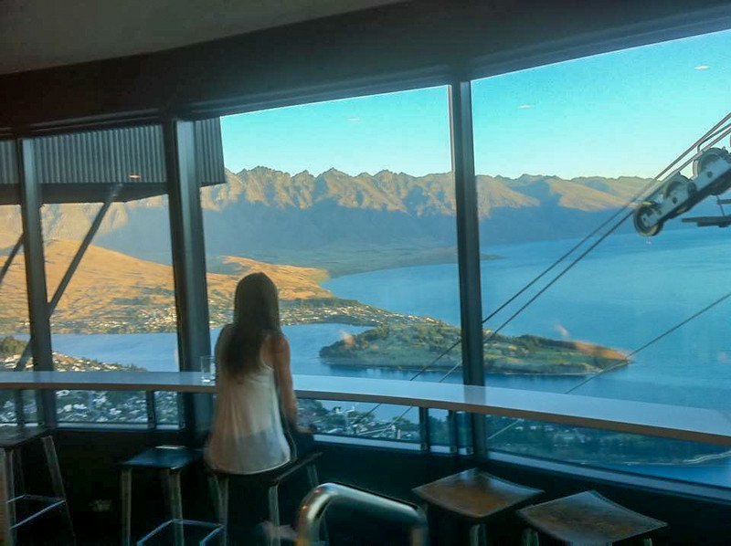 Attractive female sitting all by herself in this bar with a killer view. Now that's just not right.<br />  (taken with my iPhone)