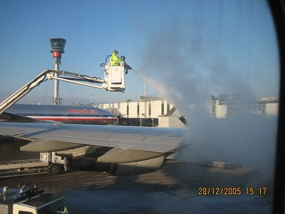 At Heathrow - just before take-off <br /> <br /> Comment : De-icing the wings with a steam blaster - after all, 'twas bliddy cold nuff!