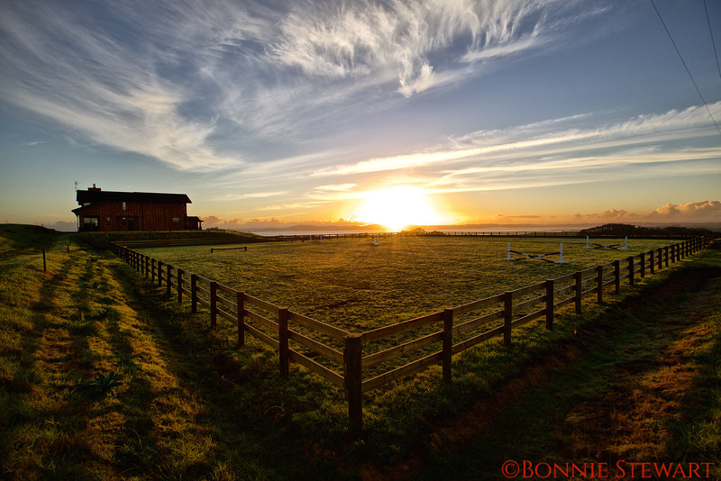 Sunrise illuminating EVER Ranch House and the Jumping Ring