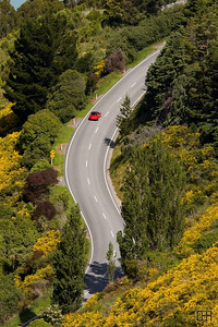 Winding road through Dyers Pass, leaving Christchurch on the way to the Banks Peninsula.  This photo is available for purchase at RedBubble.