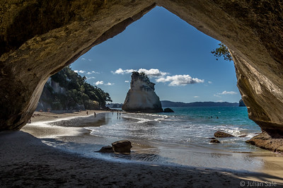 As we walked along the beach we saw what looked like a huge cave but it turned out to be an archway through to another beach.