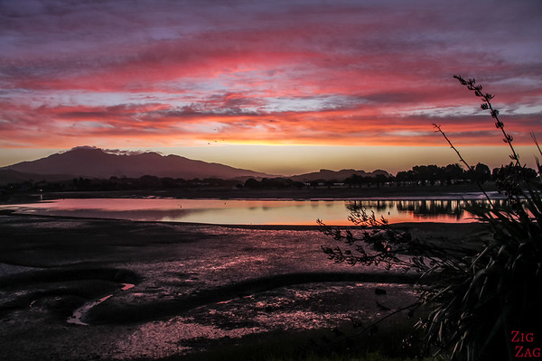 Best cities in New Zealand to stop on your itinerary - Raglan sunset
