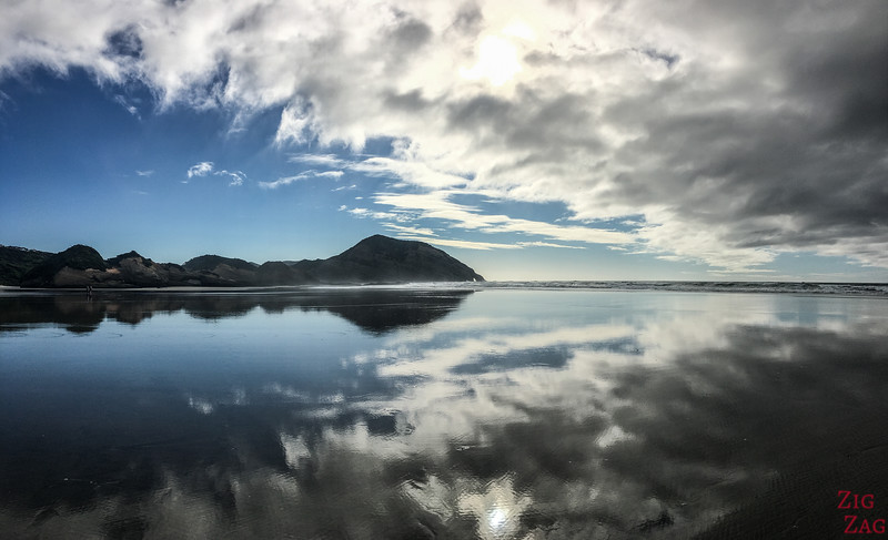 Why visit Wharariki beach New Zealand - reflections