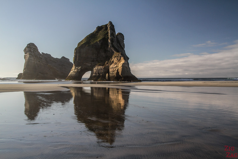 Why visit Wharariki beach New Zealand - reflections archway islands