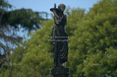 Figurine on top of a fountain in Albert Park, Auckland , New Zealand