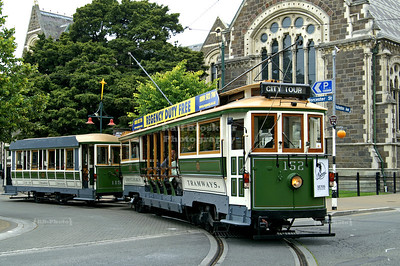 The green Christchurch Tramways car # 152 and trailer #115 on the city loop in front of the Arts Centre, Worcester Street and Rolleston Avenue, Christchurch, Canterbury, New Zealand