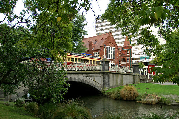 A tram on Worcester Street crossing the bridge over the river Avon with Our City O-Tautahi in the Background. Christchurch, Canterbury, New Zealand