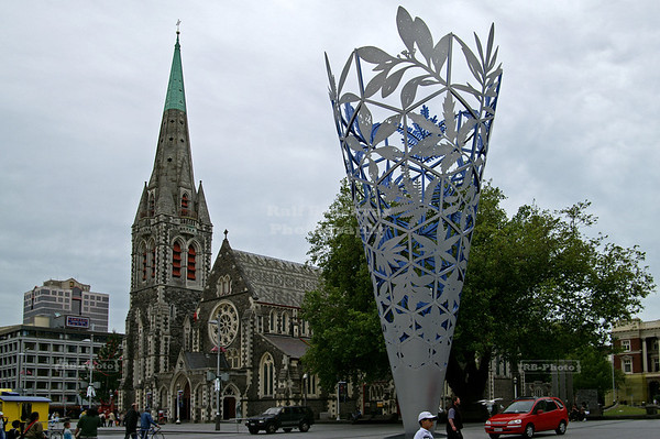 The Chalice in front of Christchurch Cathedral with the stone masonry bell tower, which later collapsed during the 2011 earthquake. Christchurch, Canterbury, New Zealand