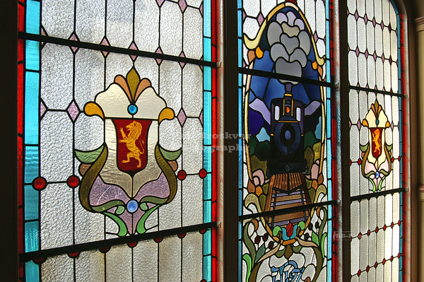 One of the two famous stained glass windows on the mezzanine in Dunedin Railway Station, which was built between 1904 and 1906. Dunedin, Otago, South Island, New Zealand