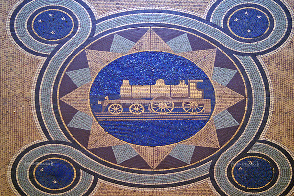 Center pieceof the mosaic floor in Dunedin Railway Station, New Zealand