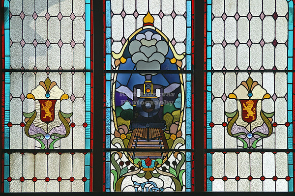 One of the two famous stained glass windows on the mezzanine in Dunedin Railway Station, which was built between 1904 and 1906. Dunedin, Otago, New Zealand