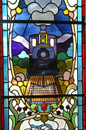 Center piece of one of the two stained glass windows on the mezzanine in Dunedin Railway Station, which was built between 1904 and 1906. Dunedin, Otago, New Zealand