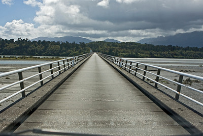 Haast River Bridge entry to the West Coast of New Zealand  The bridge over the mouth of the Haast River was completed in 1962.  At 737m it is New Zealand's longest one-lane road bridge,