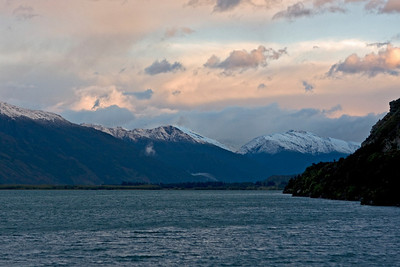 Sunrise at Lake Wanaka - from our campsite - we camped at Makarora beside Lake Wanaka and woke to find snow on the mountains.  January 2010