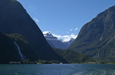 Steep mountains and a waterfall at Milford Sound, Fjordland, South Island, New Zealand