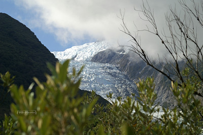 Heavy fog drifting into the valley to cover Franz Josef Glacier (Ka Roimata o Hinehukatere) in Westland Tai Poutini National Park, South Island, New Zealand