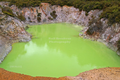 Green water in the Devil's Bath at the Wai-o-tapu Thermal Wonderland