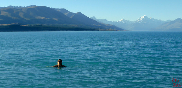 Swimming in Lake pukaki with view of Mount Cook, New Zealand
