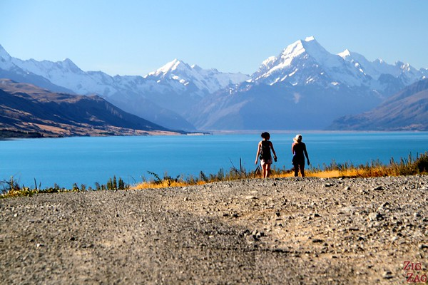 Walking along Lake pukaki with view of Mount Cook, New Zealand