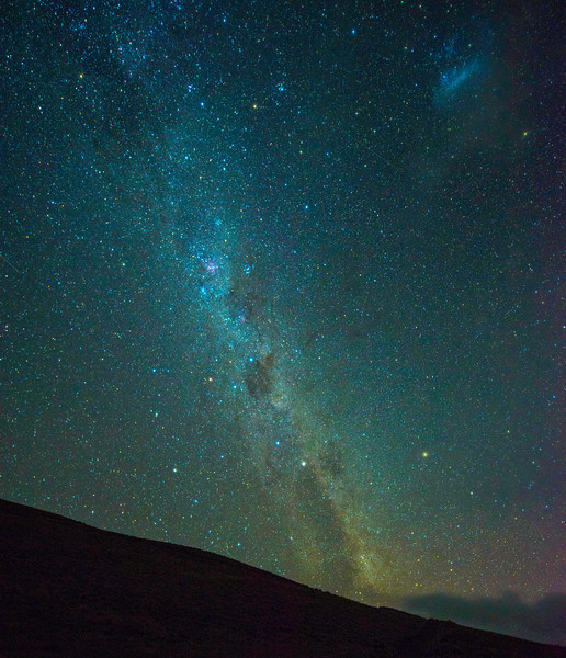 One of my favorite shots of the night sky in New Zealand. I didn't get an opportunity to do much night shooting due to cloudy skies. but this night on my way back from Wanaka the skies cooperated.<br /> This is a section of the Milky Way that is not normally visible to the Northern hemisphere. The Southern Cross is visible in the center of the photo. The Greater Magellanic cloud is upper right.  If you look very closely, you can also see 4 meteor streaks that happened during the 20 second exposure.