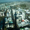 A view of Auckland from Sky Tower, and Sky Tower's shadow. You can see the extinct volcanoes in the background.