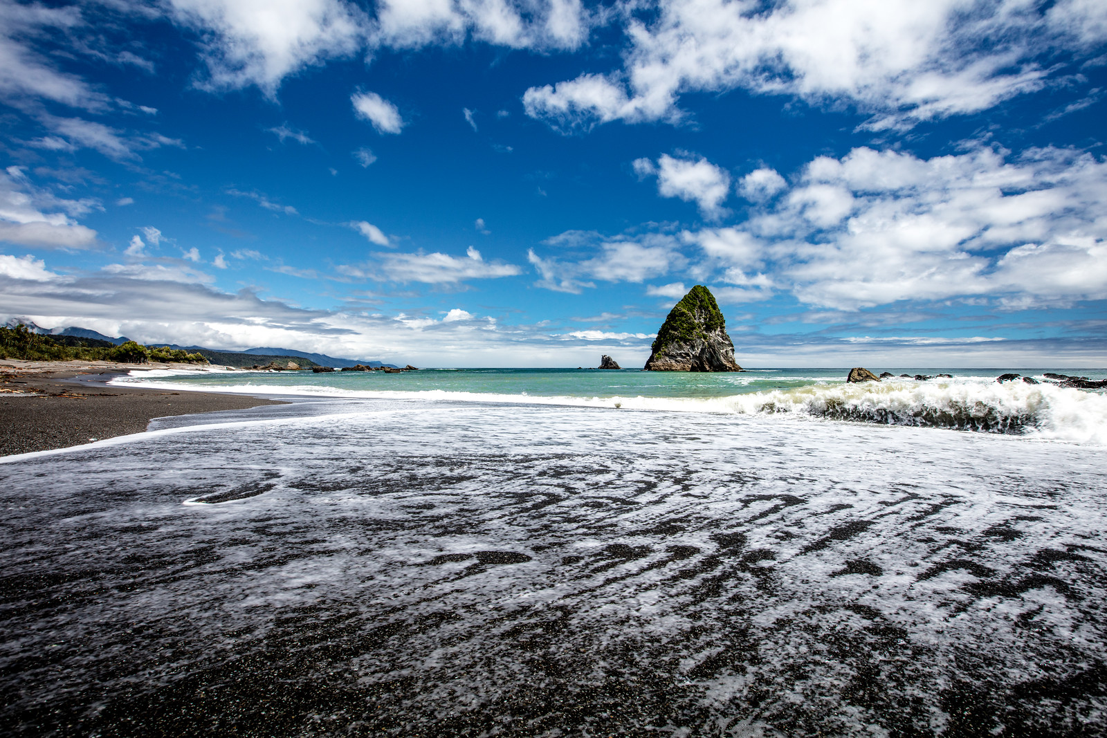 Tasman Sea and black beach