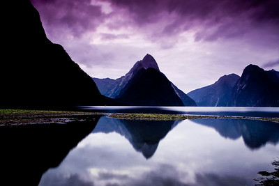 A stormy sunrise on Mitre Peak in Milford Sound, Fiordland.