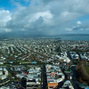 A view of Auckland from Sky Tower. You can see the extinct volcanoes in the background. It's winter time and rainy...which makes for a pretty sky.