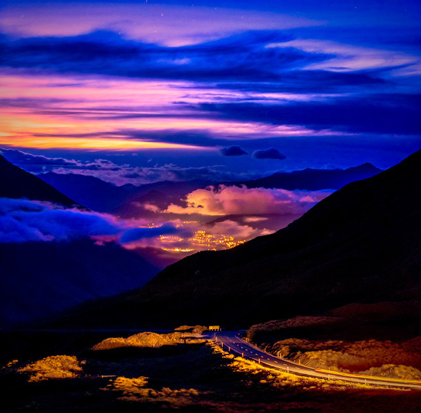 The Crown Range road from Queenstown to Wanaka.  This is looking down into the Queenstown valley at twilight.