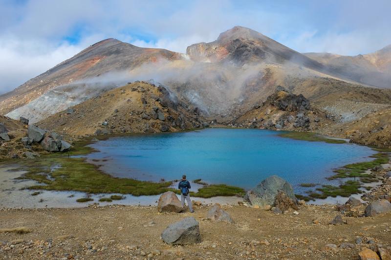 "Tongariro Alpine Crossing.  Beautiful ""lake"".  Finally starting to see some sun."
