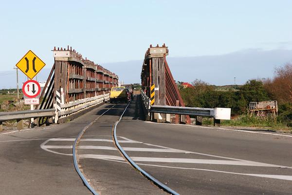 one-lane car and train bridge