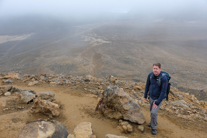 John and I make the 12 mile hike over the Tongariro Alpine Crossing, considered one of the world's best dayhikes.  We still haven't reached the summit in this picture.  The trail ascends some 2500 feet to the summit and descends approx. 3700 feet.