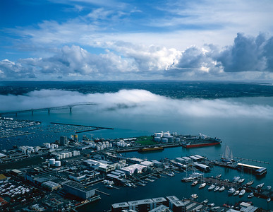 Fog rolls in over the Auckland Harbor Bridge. This view of Auckland Harbor was taken from the Sky Tower, looking to the North West.