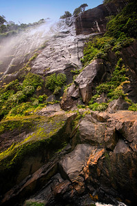One of the many waterfalls in Milford Sound, Fiordland National Park New Zealand.