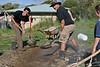 Preparing a hangi earth-baked meal, Ohau