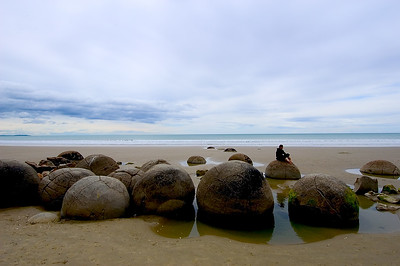 Figure on Moeraki Boulders- Koekohe Beach, New Zealand