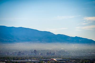 Albuquerque new mexico skyline in smog  with mountains