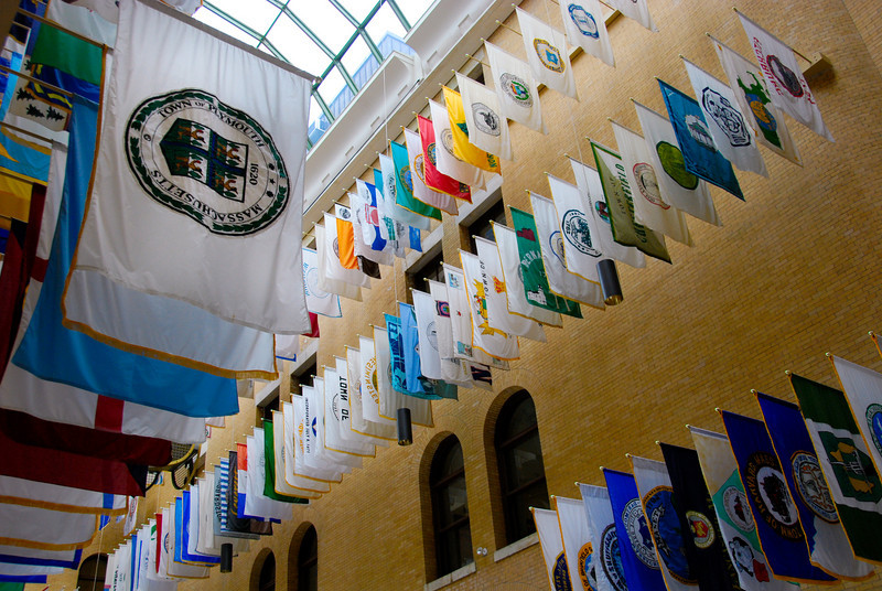 Great Hall of Flags in the MA State House. There are flags from most of the cities and towns in MA.