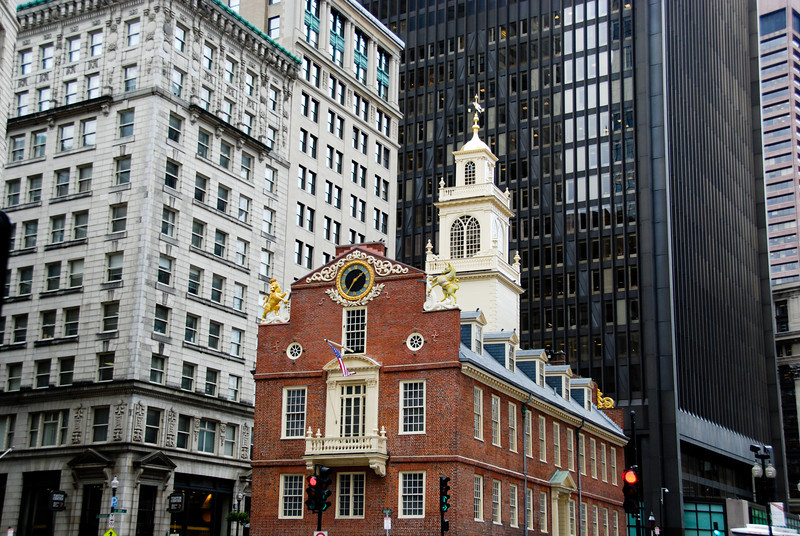 The Old State House, which is now a museum. The Boston Massacre happened in front of this building, and the Declaration of Independence was read to citizens for the first time from the balcony. This building was built for the British government and then used as the State House after the Revolution.<br /> I really like how small it looks nestled in modern downtown Boston.